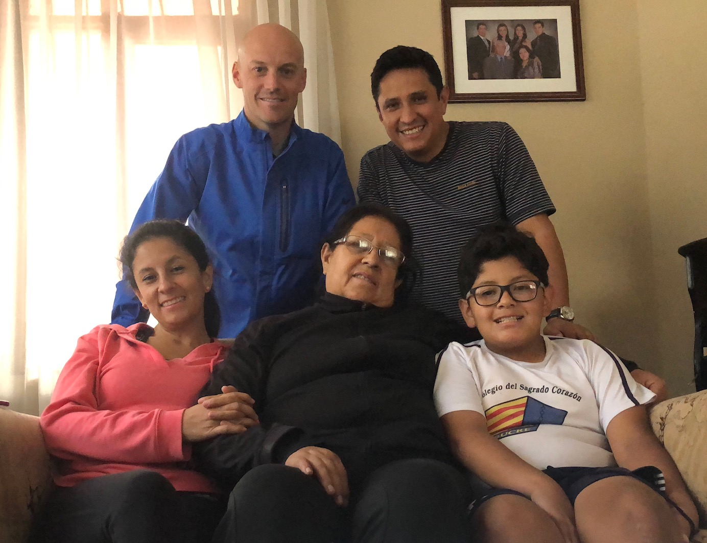 Scott Mortensen (top left) with members of the Perez Quiroz family in the same home where he taught them 20 years ago in Sucre, Bolivia. Mortensen visited the family in October.