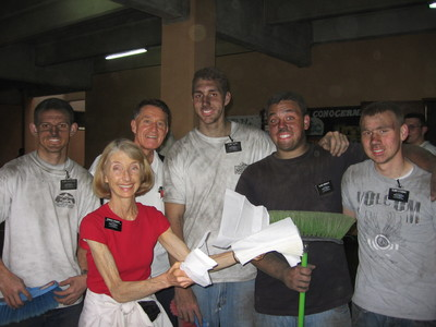 Sister Jeanne Groberg, wife of MTC president Joseph H. Groberg, hands out paper towels to help missionaries clean up after they finished the dirty task of cleaning the outside windows.