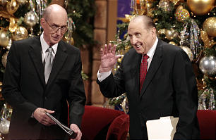 President Thomas S. Monson, right, waves to the crowd as he and President Henry B. Eyring, left, take the stand before the annual First Presidency Devotional in the Conference Center Sunday, Dec. 6, 2009.