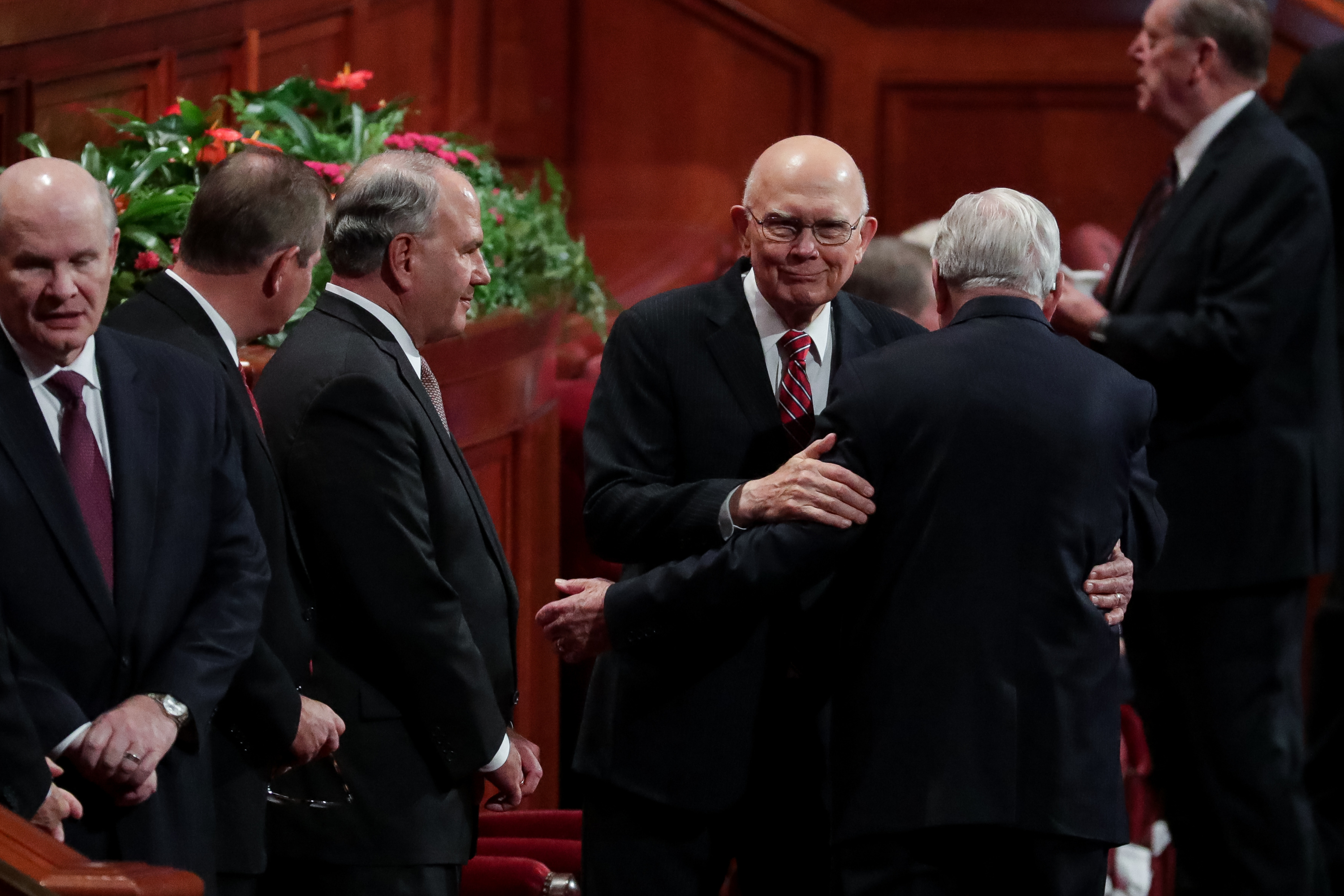 President Dallin H. Oaks, first counselor in the First Presidency, center, greets President M. Russell Ballard, acting president of the Quorum of the Twelve Apostles, right, before the start of the Saturday morning session of the 188th Semiannual General Conference of The Church of Jesus Christ of Latter-day Saints in the Conference Center in Salt Lake City on Saturday, Oct. 6, 2018.