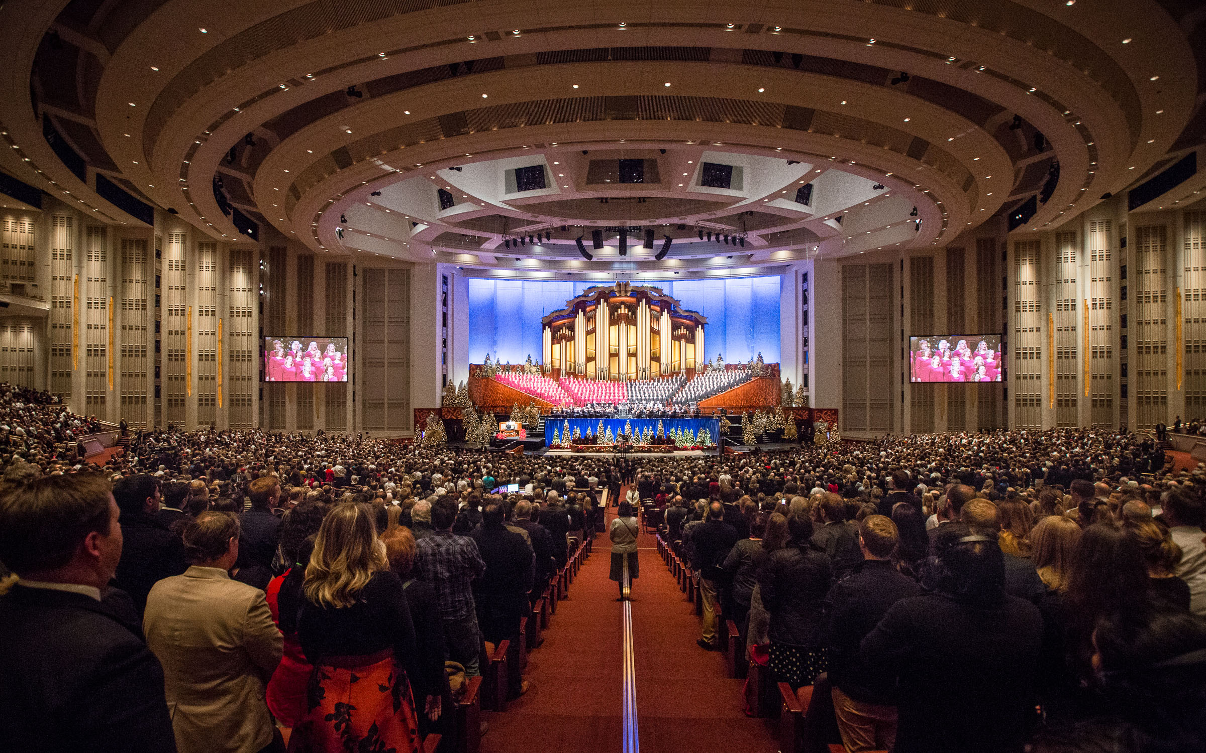 """People stand for the """"Hallelujah Chorus"""" during the First Presidency's Christmas Devotional in the Conference Center in Salt Lake City on Sunday, Dec. 2, 2018."""
