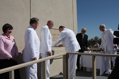 President Thomas S. Monson applies mortar to the cornerstone of The Gila Valley Arizona Temple, the Church's 132nd temple worldwide. From left, President Henry B. Eyring, first counselor in the First Presidency, Elder Jeffrey R. Holland of the Twelve, and Elder William R. Walker of the Seventy look on.