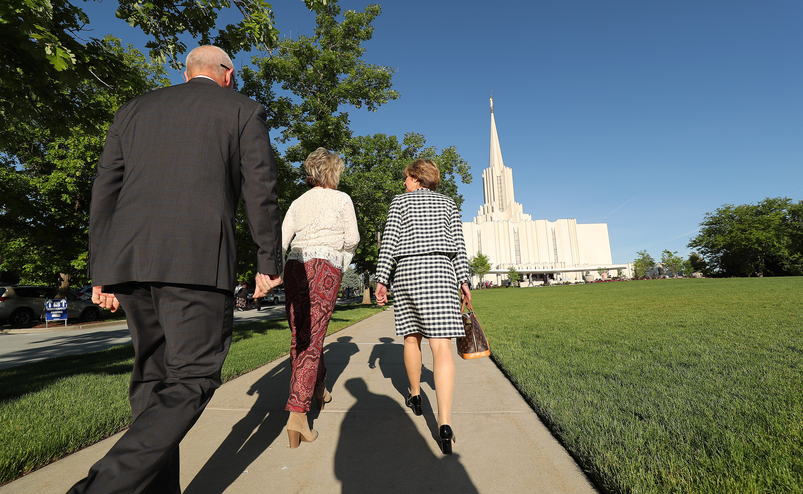 Attendees arrive for the Jordan River Utah Temple as it is rededicated in South Jordan on Sunday, May 20, 2018.