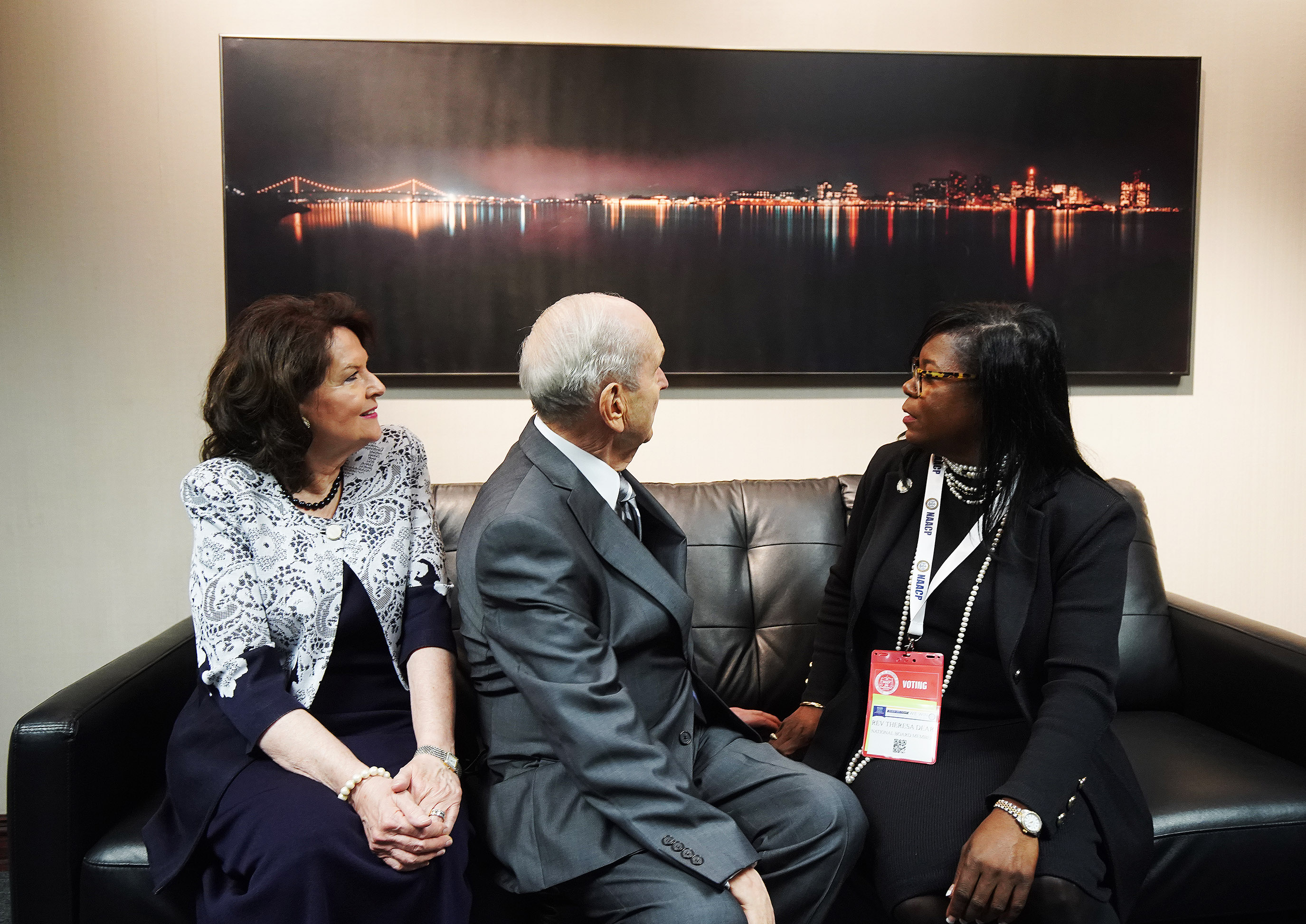 President Russell M. Nelson of The Church of Jesus Christ of Latter-day Saints and his wife, Sister Wendy Nelson, look over a photo of Detroit with the Rev. Theresa Deer while meeting with NAACP leaders at the 110th annual national convention for the National Association for the Advancement of Colored People in Detroit, Michigan, on Sunday, July 21, 2019.