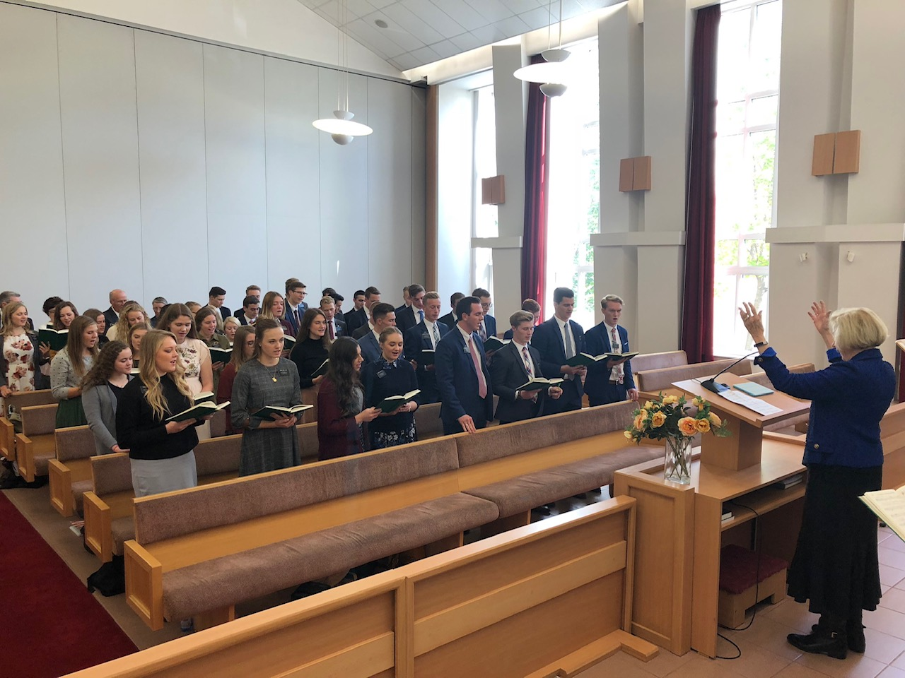 Sister Mary G. Cook sings with missionaries in the Church's Europe East Area.