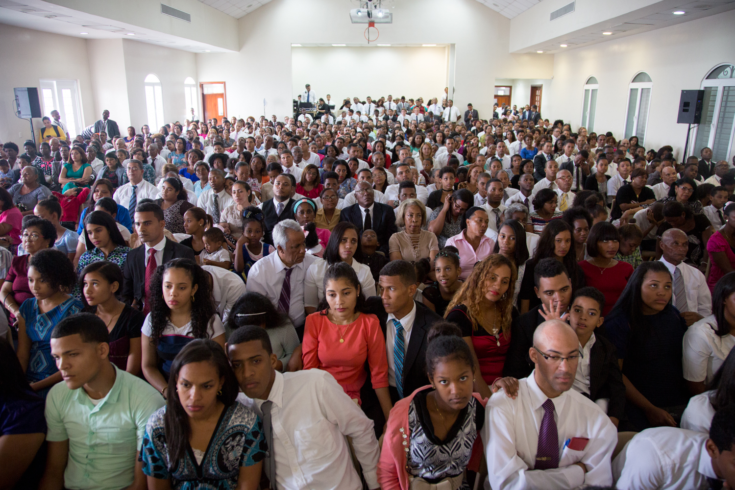 Audience members squeeze into a stake center in Santo Domingo, Dominican Republic, for a Sept. 1, 2018, member devotional presided by President Russell M. Nelson.