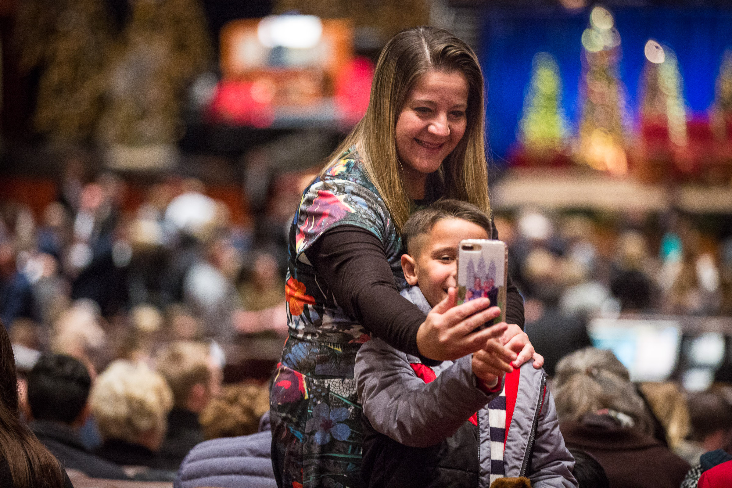 Attendees take a selfie before the First Presidency's Christmas Devotional starts in the Conference Center in Salt Lake City on Sunday, Dec. 2, 2018.