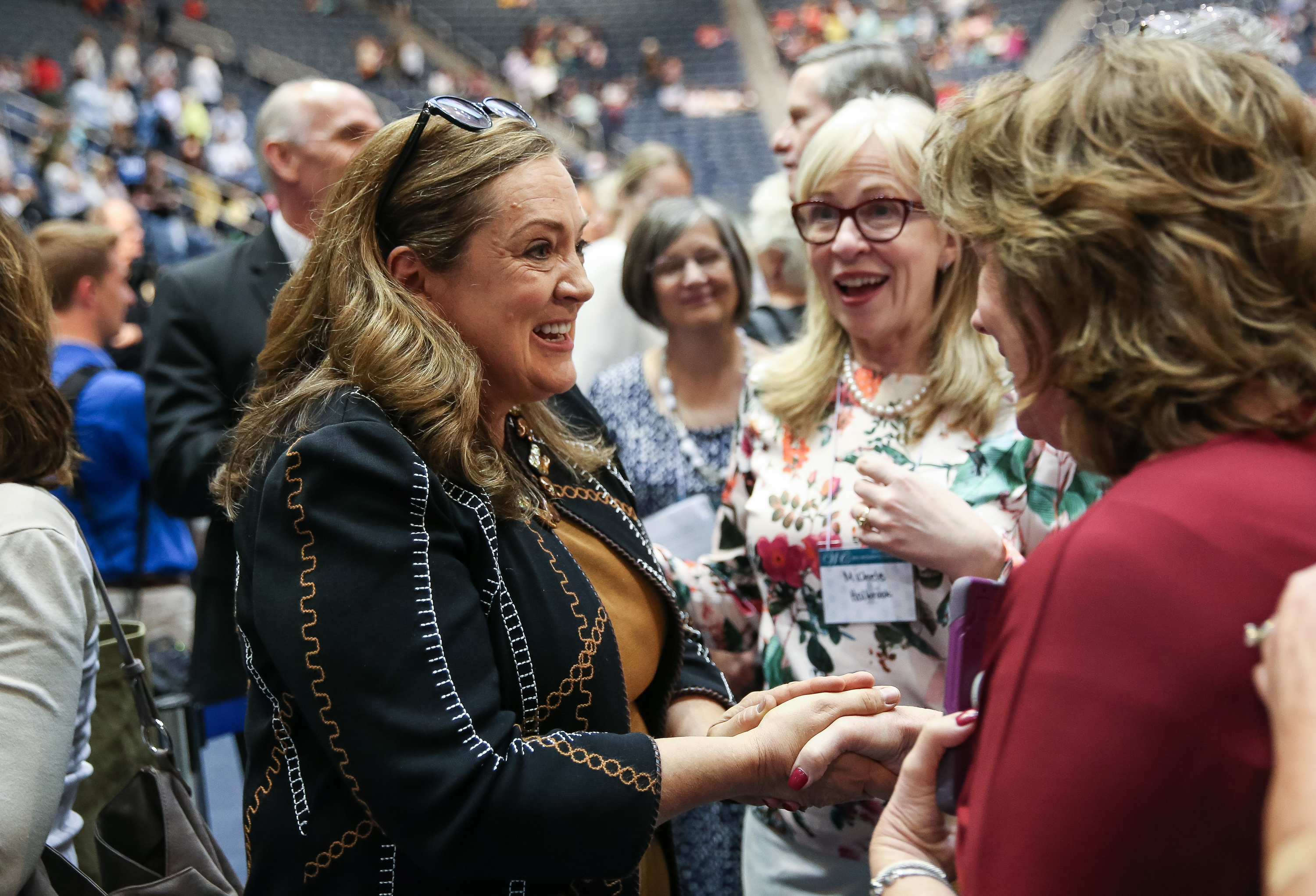 Sister Susan Gong, wife of Elder Gerrit W. Gong, of the Quorum of the Twelve Apostles of the LDS Church, greets attendees after she and her husband spoke at the BYU Women's Conference at the Marriott Center in Provo on Friday, May 4, 2018.