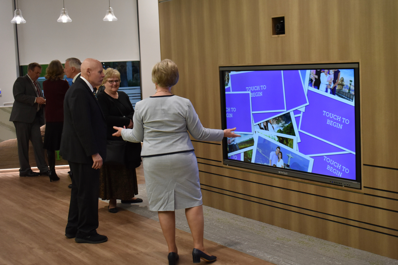 Visitors to the April 30, 2019, dedication services of the new Ogden Utah FamilySearch Center explore the interactive media on the main floor.