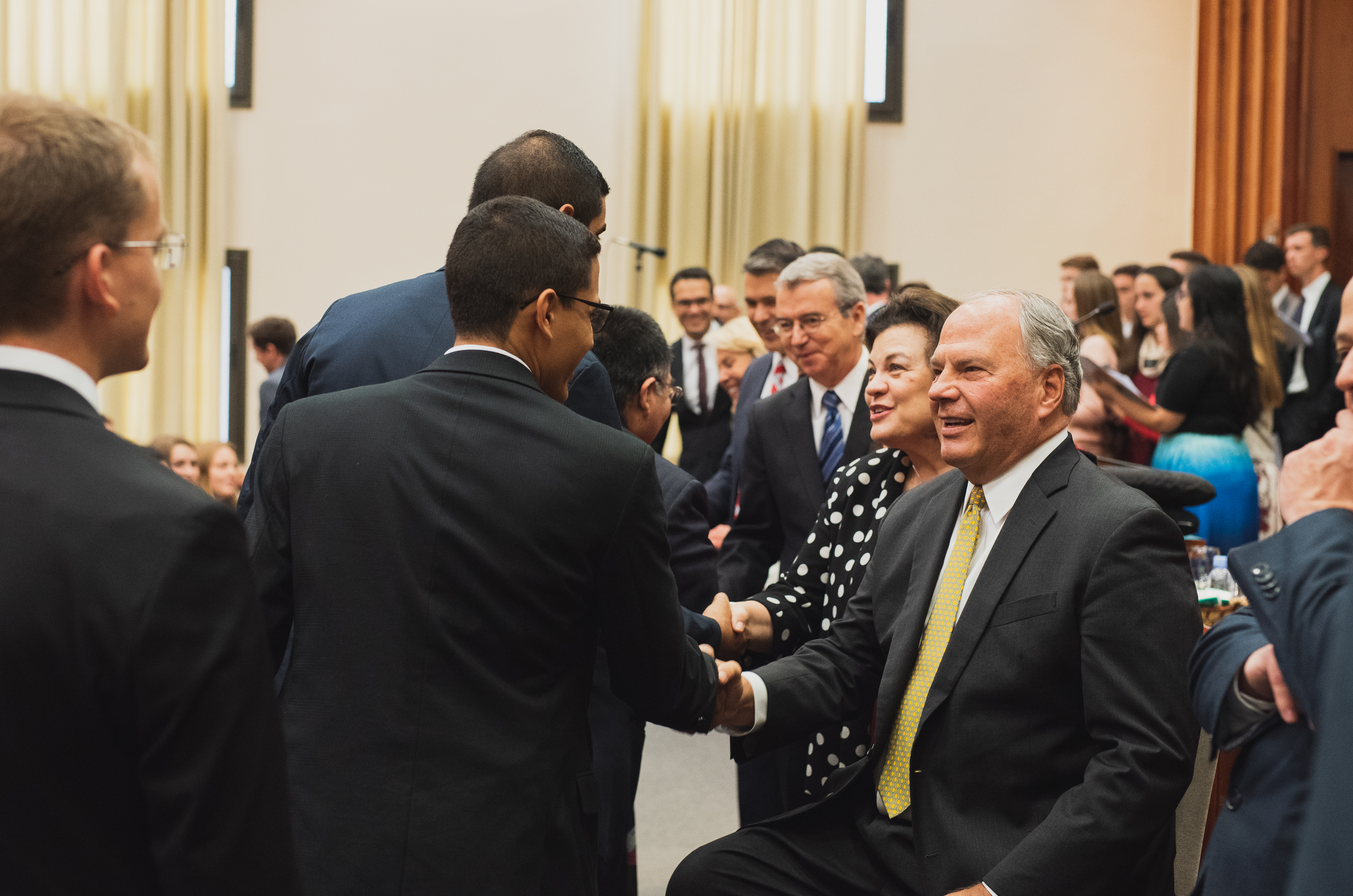 Elder Ronald A. Rasband of the Quorum of the Twelve Apostles is joined by his wife, Sister Melanie Rasband, and Elder Carlos A. Godoy of the Presidency of the Seventy in greeting missionaries. The Rasbands met with missionaries and mission leaders in three countries during the late August and early September 2018 trip to the South America South Area.