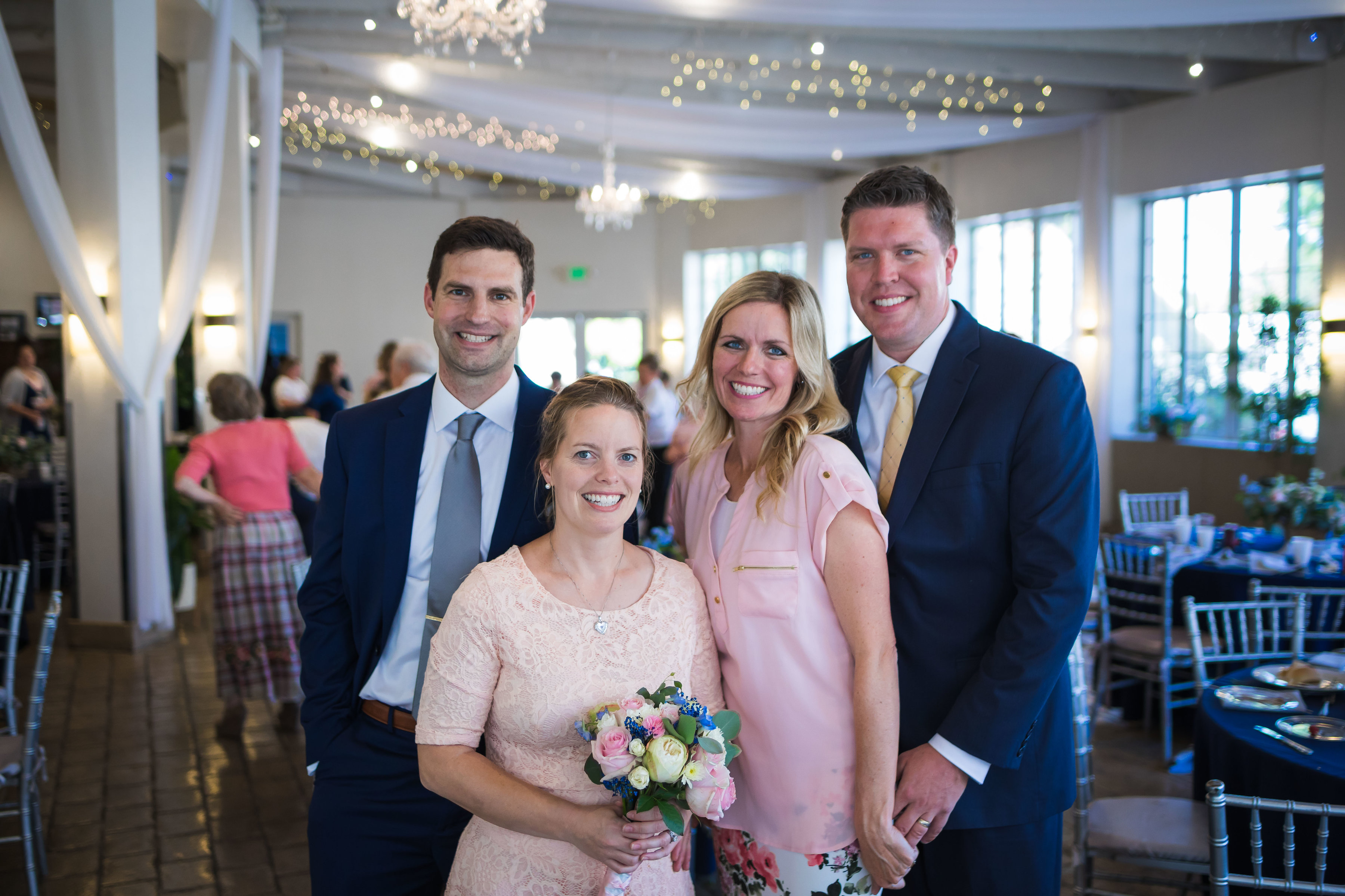 Jacob and Marin Evans, left, with their friends Lisle and MayAnn Updike at their wedding luncheon.