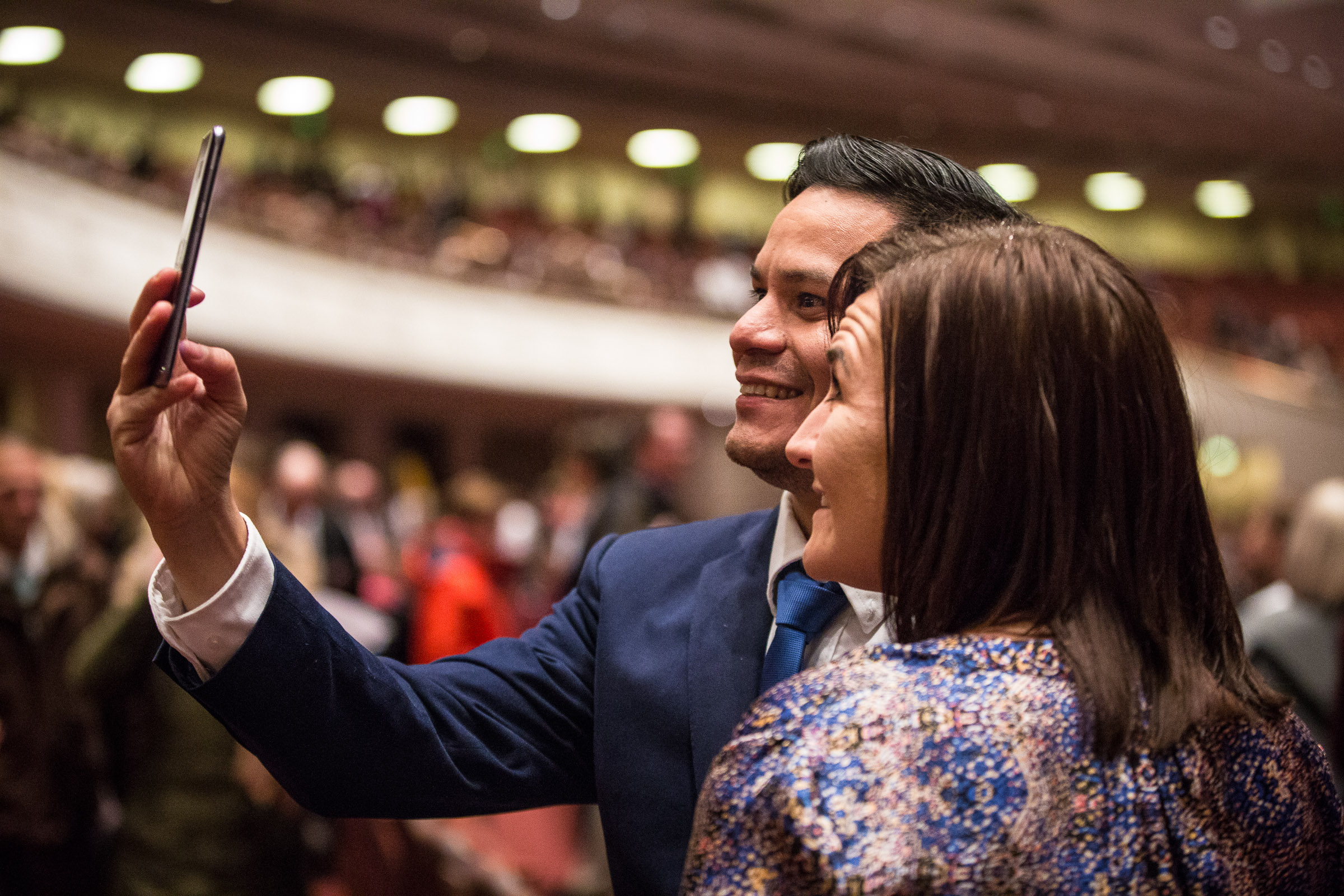A couple takes a selfie before the First Presidency's Christmas Devotional in the Conference Center in Salt Lake City on Sunday, Dec. 2, 2018.