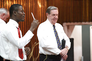 Elder Holland listens during a question-and-answer session at one of the priesthood leadership training meetings held in West Africa.