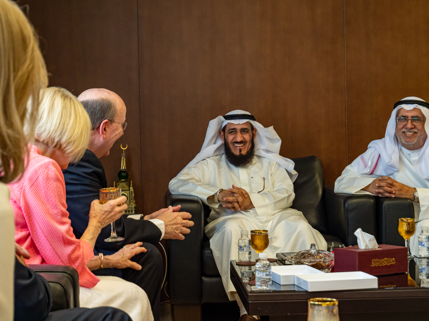 Elder Quentin L. Cook and his wife, Sister Mary Cook, speak to Mr. Fareed Emadi, secretary general of the Supreme Commission for the Promotion of Moderation in the Ministry of Awqaf, and others in Kuwait City on June 10, 2019.