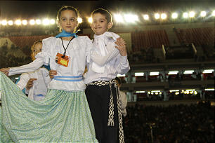 Young people of all ages participated in the cultural event, including these two Primary children who performed a familiar folk dance in traditional garb.