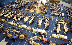 Thousands of volunteers work to put together hygiene kits and care packages during a service project held in the Smith Fieldhouse as part of BYU's annual women's conference Thursday, May 3, 2007. Photo by Jason Olson