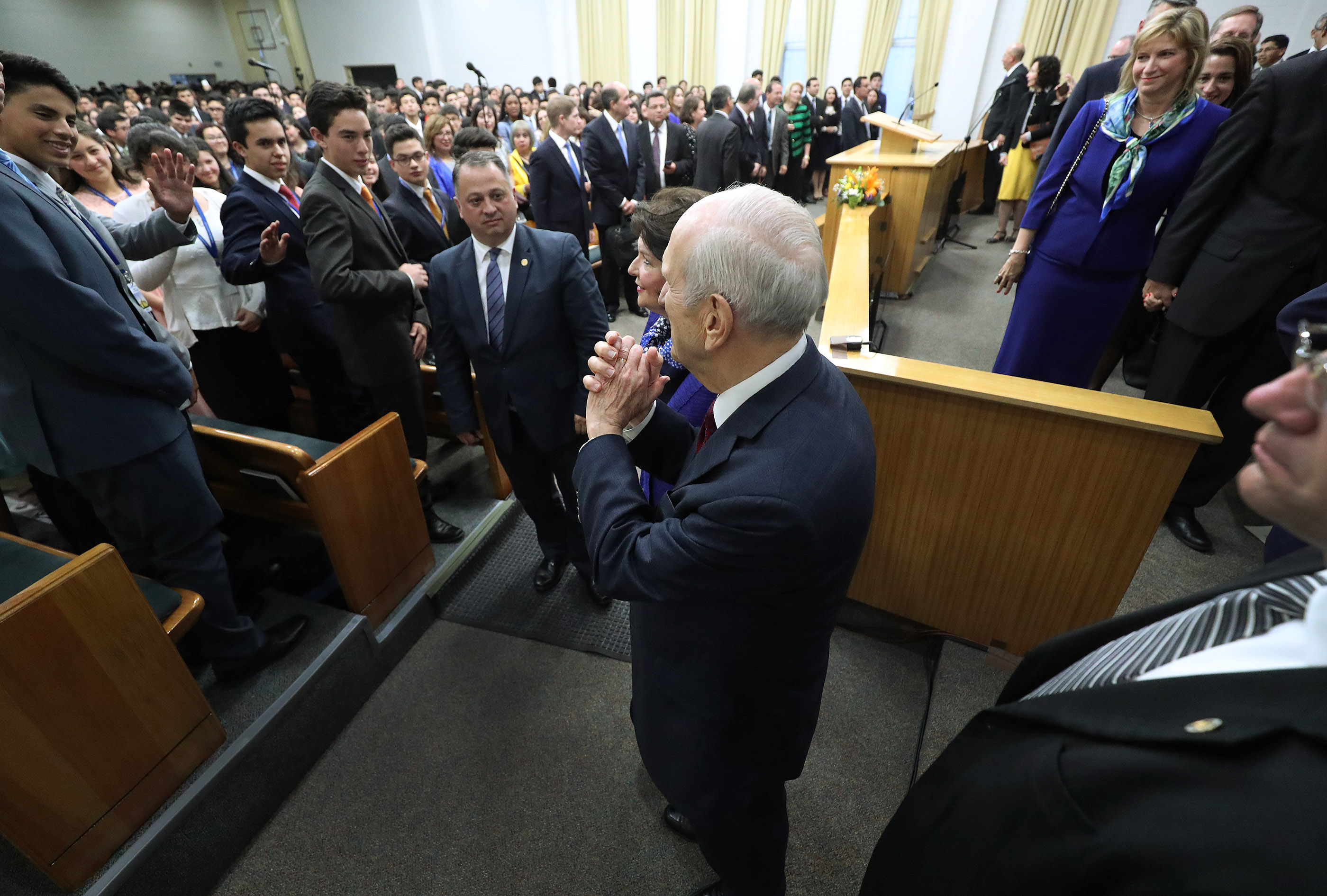 President Russell M. Nelson of The Church of Jesus Christ of Latter-day Saints gestures to attendees after a youth devotional in Concepcion, Chile, on Saturday, Oct. 27, 2018.