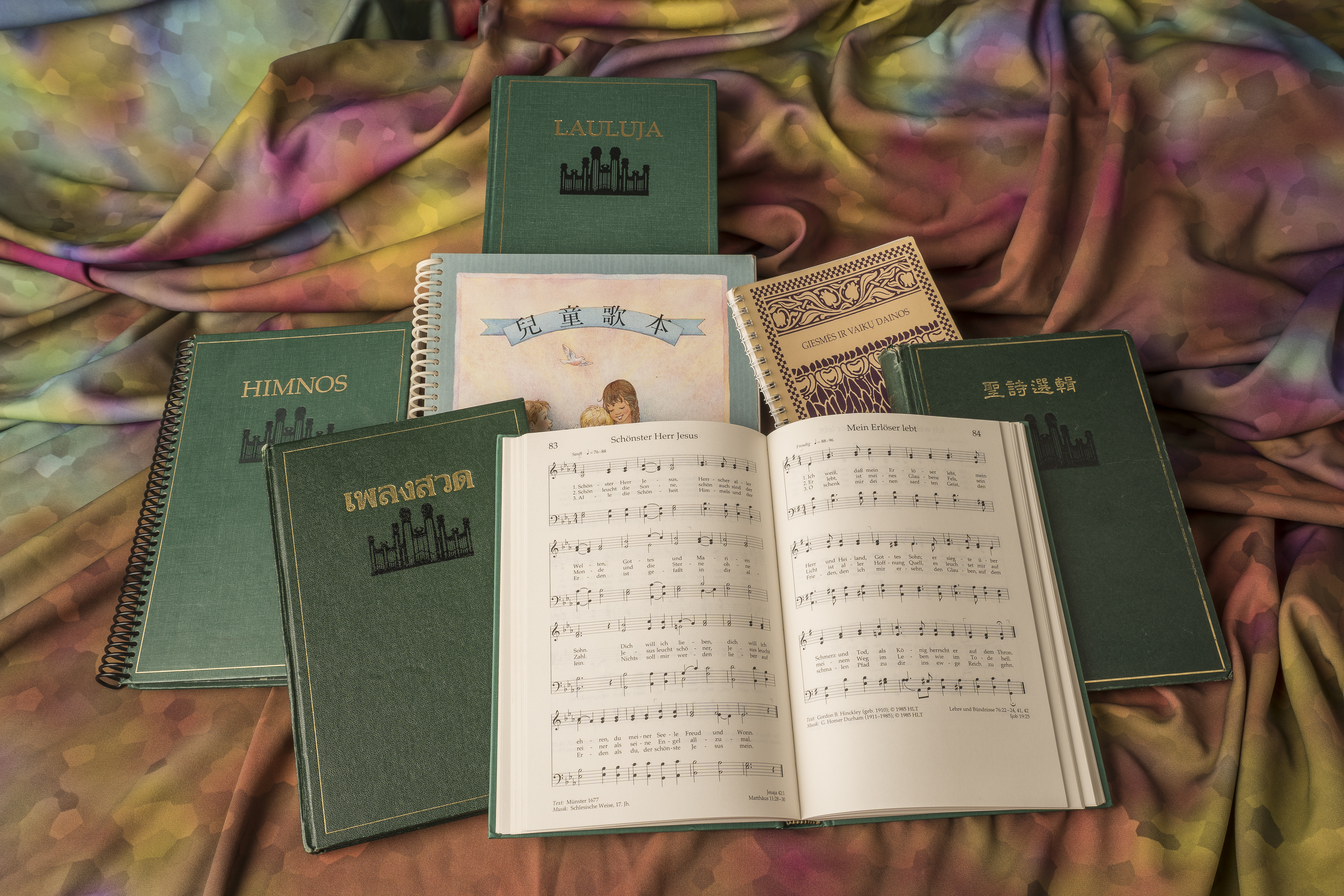 Various language versions of the current Hymns and Children's Songbook. The Church has announced it is revising the hymnbook and children's songbook and invites members to participate.