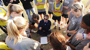 "North Carolina women's soccer coach Anson Dorrance offers instruction during a team practice. A convert to the Church, Coach Dorrance utilizes ""secularized"" gospel principles to teach and direct his team. He has coached some of history's top female players."
