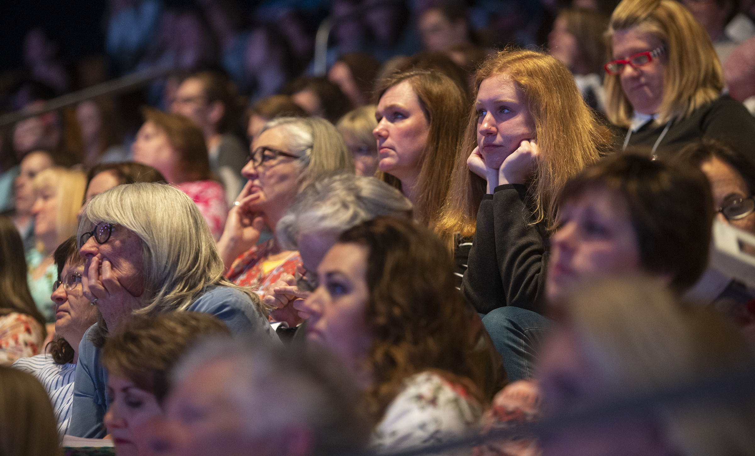 "Women listen as they attend a ""Sister to Sister"" event during Women's Conference at BYU's Marriott Center in Provo, Utah, on Friday, May 3, 2019."