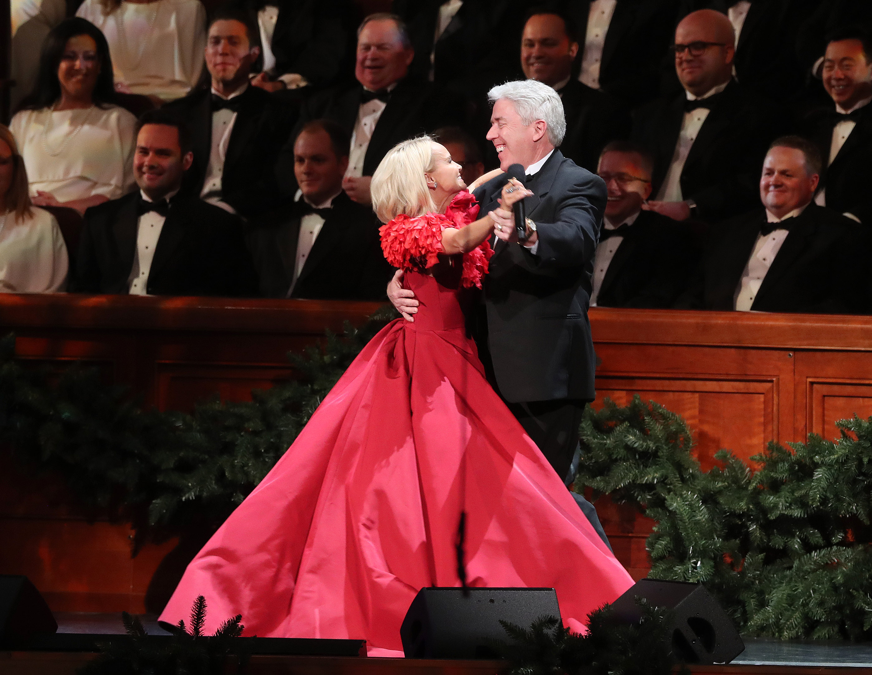 Kristin Chenoweth dances with a choir member while singing with the Tabernacle Choir at Temple Square during their opening Christmas concert at the Conference Center in Salt Lake City on Thursday, Dec. 13, 2018.