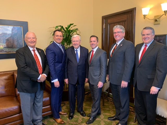 President M. Russell Ballard, Acting President of the Quorum of the Twelve Apostles, third from the left, is joined by Utah's speaker of the House of Representatives Brad Wilson, third from right, and by four former House speakers — Robert H. Garff, left; Greg Hughes, second from left; David Clark, second from right; and Marty Stephens, right. President Ballard offered the invocation in the House on the opening day of the 2019 legislative session, Jan. 28, 2019.