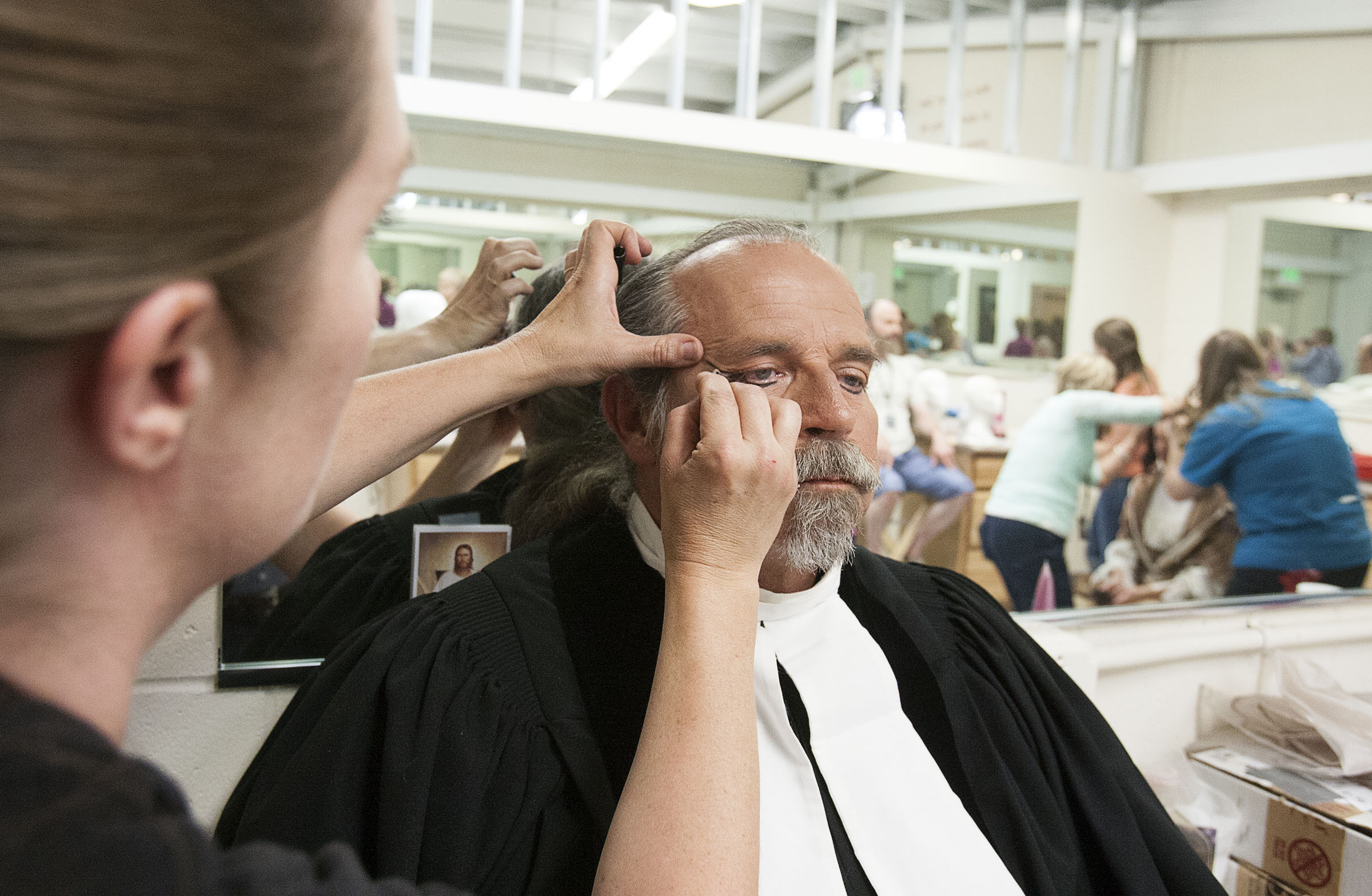Jack Keisel, who portrays a revival preacher, gets a final touch of makeup before the Mormon Miracle Pageant in Manti on Wednesday, June 15, 2016.