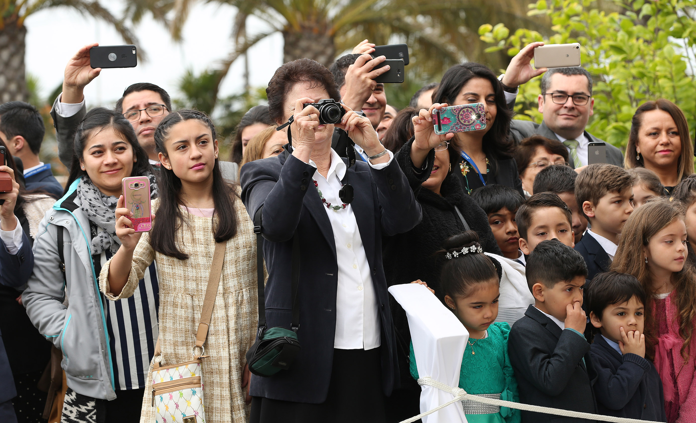 Attendees photograph the President Russell Nelson during the dedication of the Concepcion Chile Temple in Concepcion, Chile, on Sunday, Oct. 28, 2018.