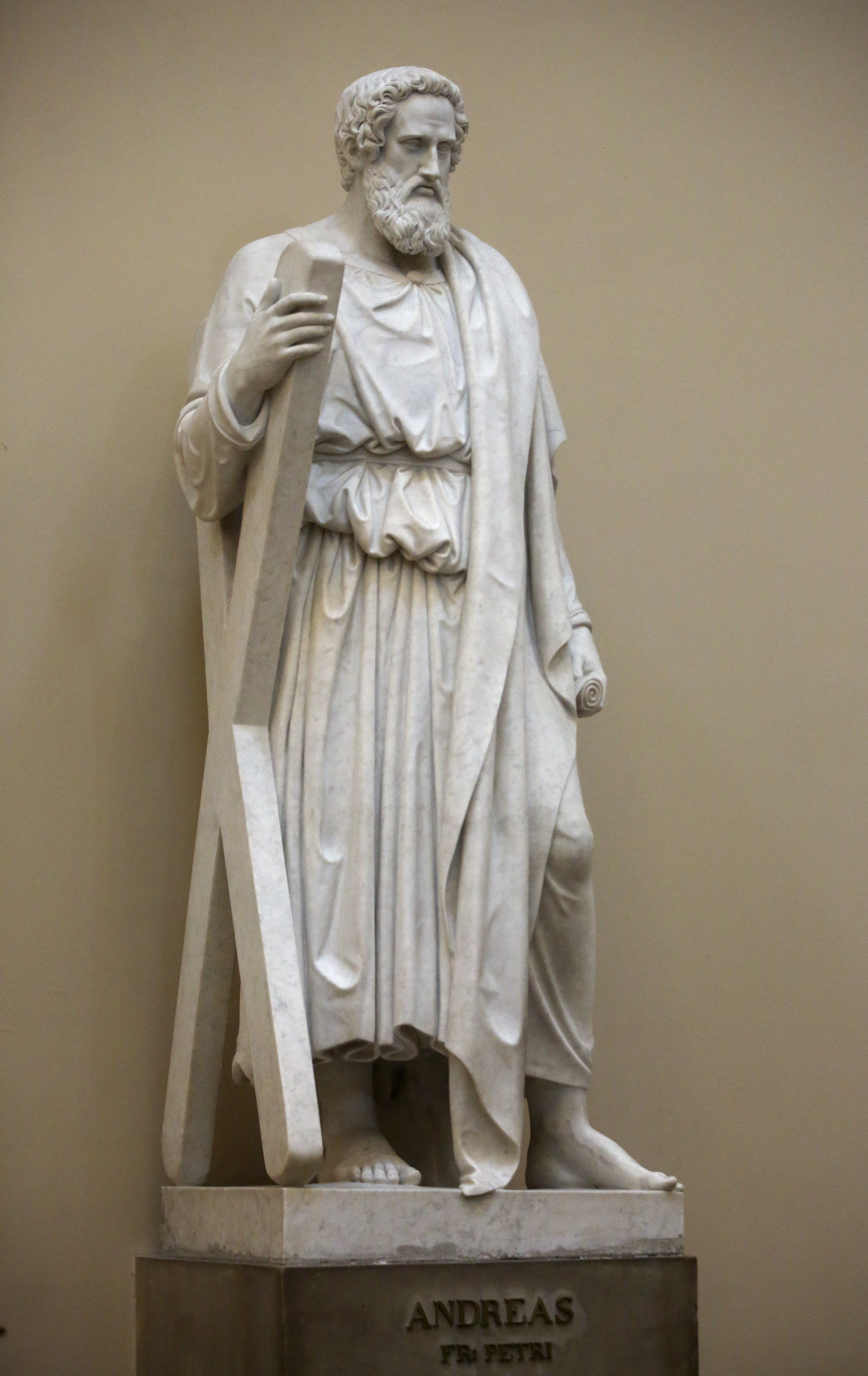 Bertel Thorvaldsen's statue of Andrew, one of the 12 apostles, holds a scroll and a large X-shaped cross at the Church of Our Lady in Copenhagen, Denmark, on Tuesday, Nov. 13, 2018. The 12 apostles statues were carved out of Carrara marble between 1829 and 1848. Replicas of the statues are now on display in the Rome Temple Visitors' Center in Italy.