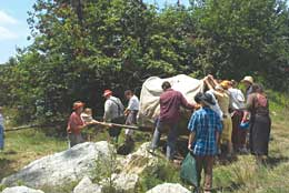 "Youth from the York Pennsylvania Stake negotiate their ""Rocky Ridge"" during their handcart trek in a state park this summer. The stake has joined many others in making handcart treks a meaningful experience for youth spiritually and in other ways."