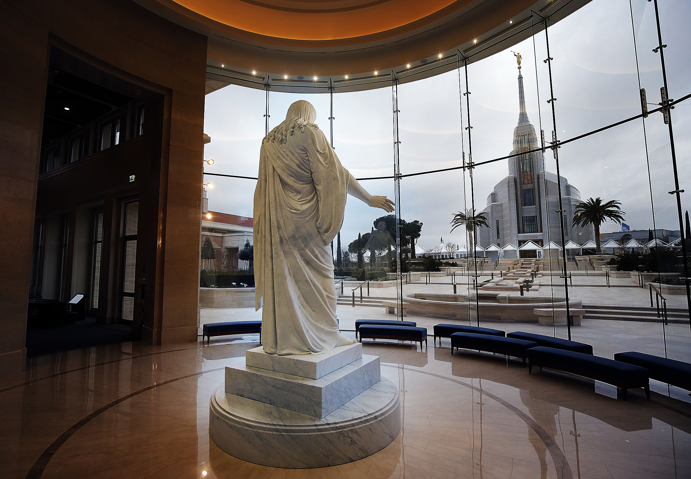 A statue of Christ is seen in the Rome Temple Visitors' Center of The Church of Jesus Christ of Latter-day Saints in Rome on Sunday, Jan. 13, 2019. In the background is the Rome Italy Temple.