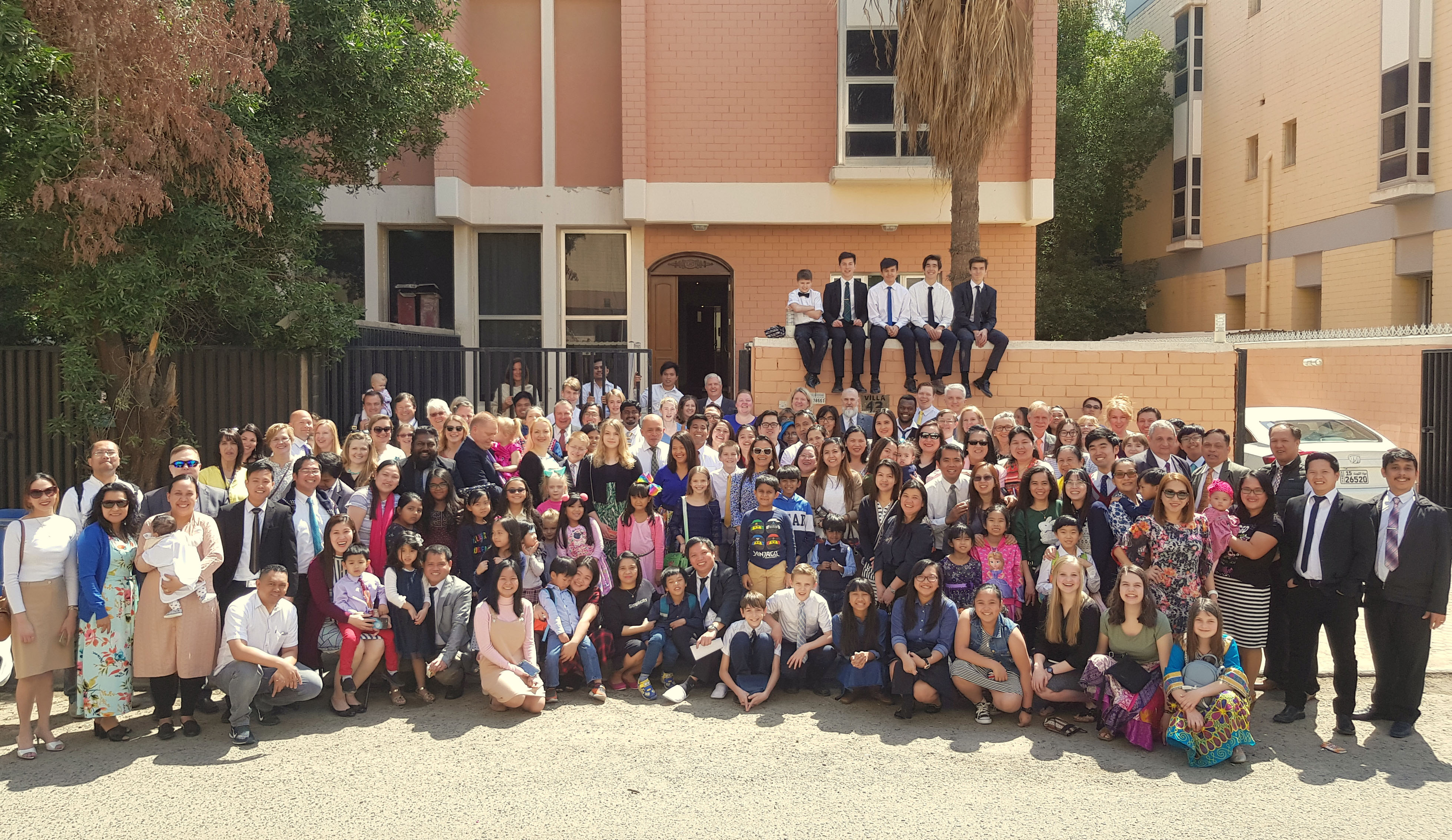 Latter-day Saints and friends gather in front of the meetinghouse in Kuwait.