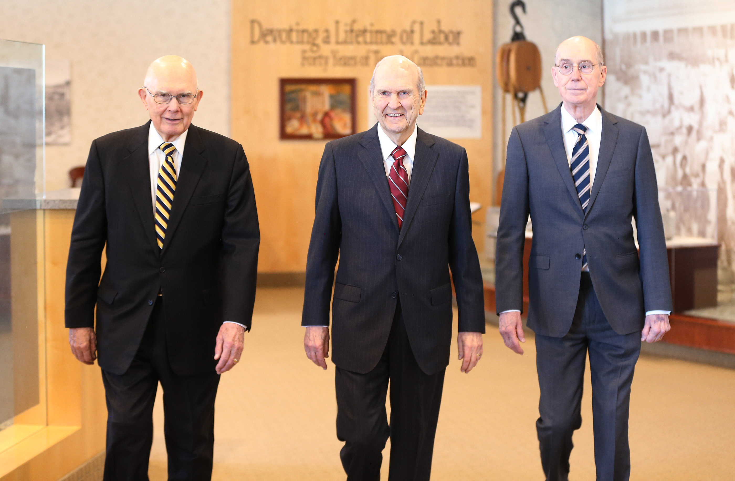 President Russell M. Nelson of The Church of Jesus Christ of Latter-day Saints, center, and his First Presidency counselors, President Dallin H. Oaks, first counselor, left, and President Henry B. Eyring, second counselor, right, walk through the South Visitors' Center prior to a press conference in Salt Lake City on Friday, April 19, 2019.