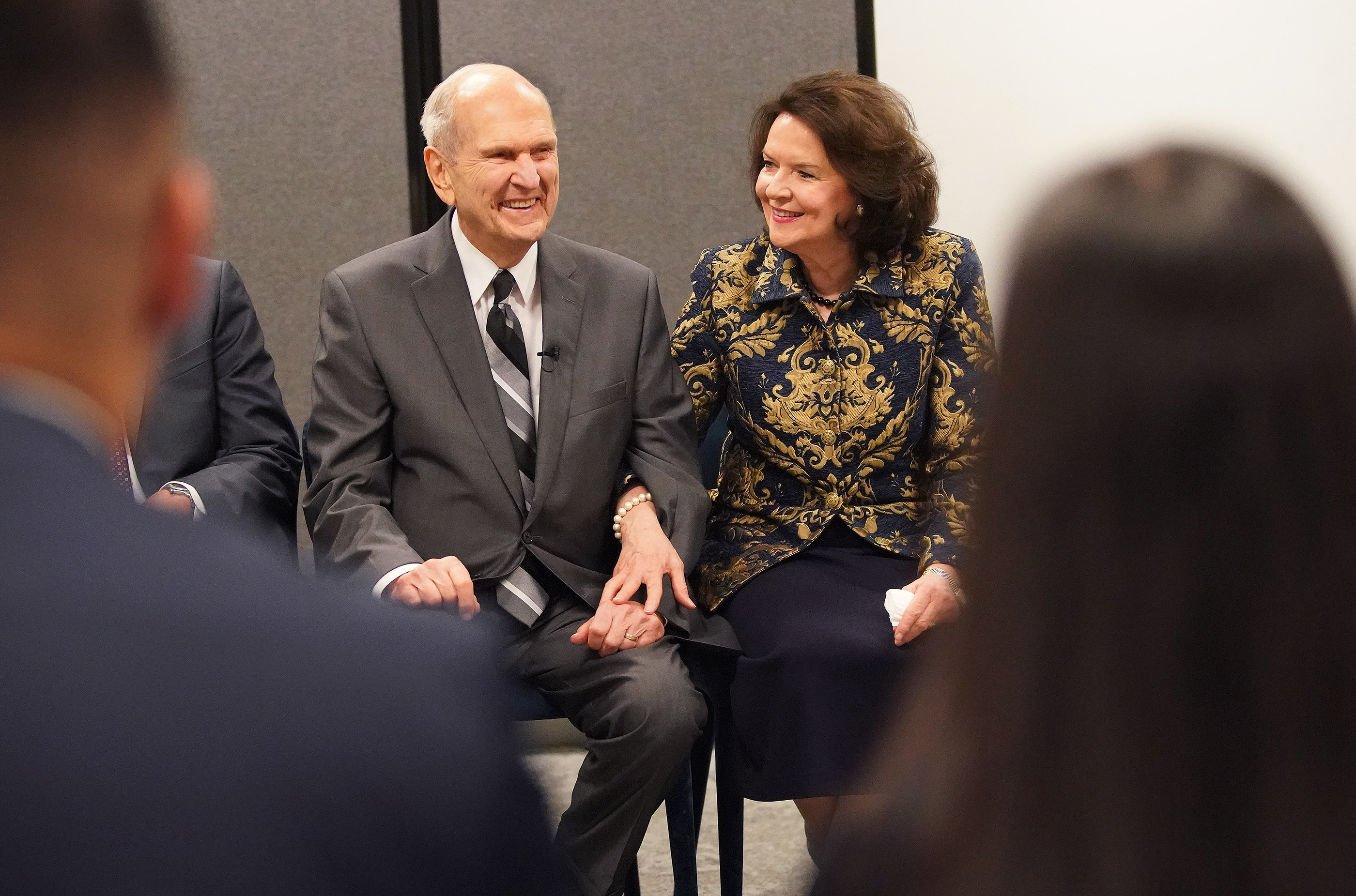 President Russell M. Nelson of The Church of Jesus Christ of Latter-day Saints and his wife, Sister Wendy Nelson, laugh as they meet with youth during a meeting on May 19, 2019, in Sydney, Australia.