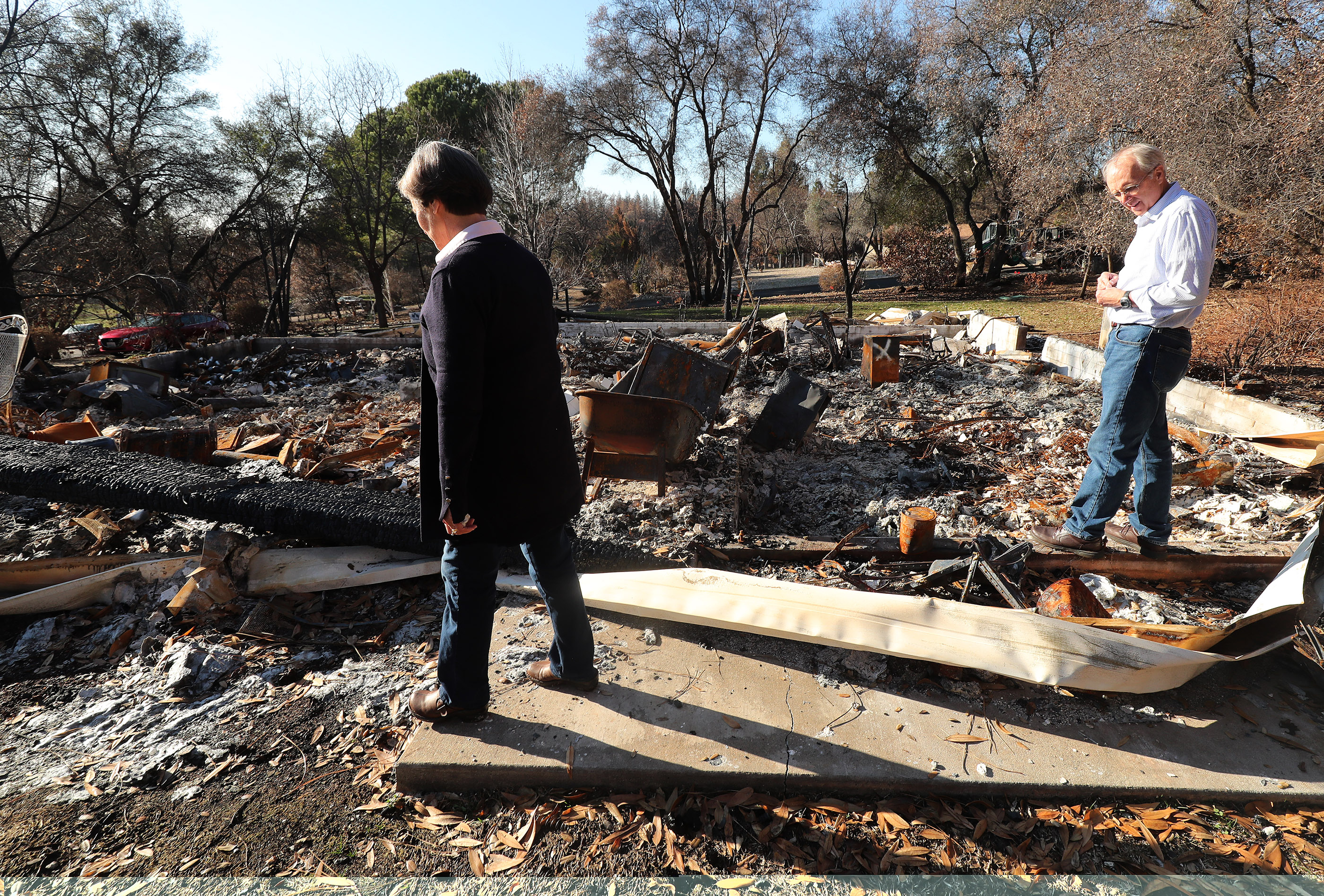 Rick and Kathie Turner look over their destroyed home in Paradise, California, on Saturday, Jan. 12, 2019, two months after the Camp Fire destroyed destroyed more than 18,000 homes and businesses.