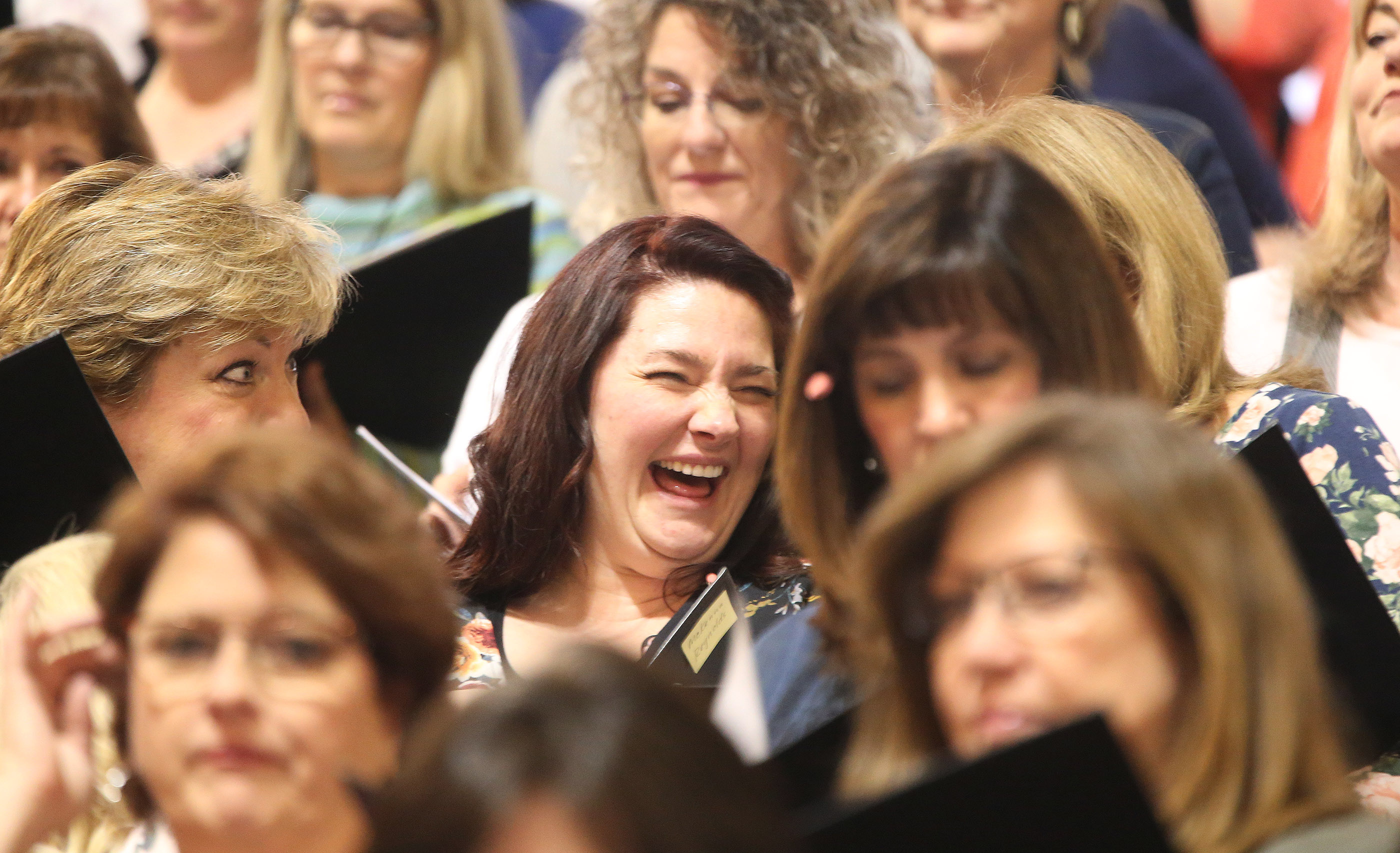 McKenna Reynolds laughs while rehearsing with The Tabernacle Choir at Temple Square during a rehearsal in Salt Lake City on Thursday, April 11, 2019. Four people were selected through social media to sing with the choir.