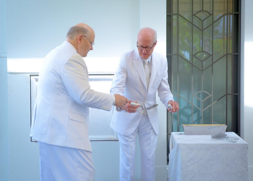 Elder Dale G. Renlund, left, of the Quorum of the Twelve Apostles conducts the cornerstone ceremony of the Kinshasa DR Congo Temple, assisted by Elder Larry Y. Wilson, a General Authority Seventy and executive director of the Temple Department, on Sunday, April 14, 2019. The cornerstone ceremony symbolizes the completion of the temple and its readiness to be dedicated for sacred use.