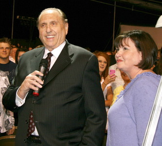 President Thomas S. Monson speaks during the cultural celebration. On the right is Sister Ann M. Dibb, President Monson's daughter and second counselor in the Young Women general presidency.