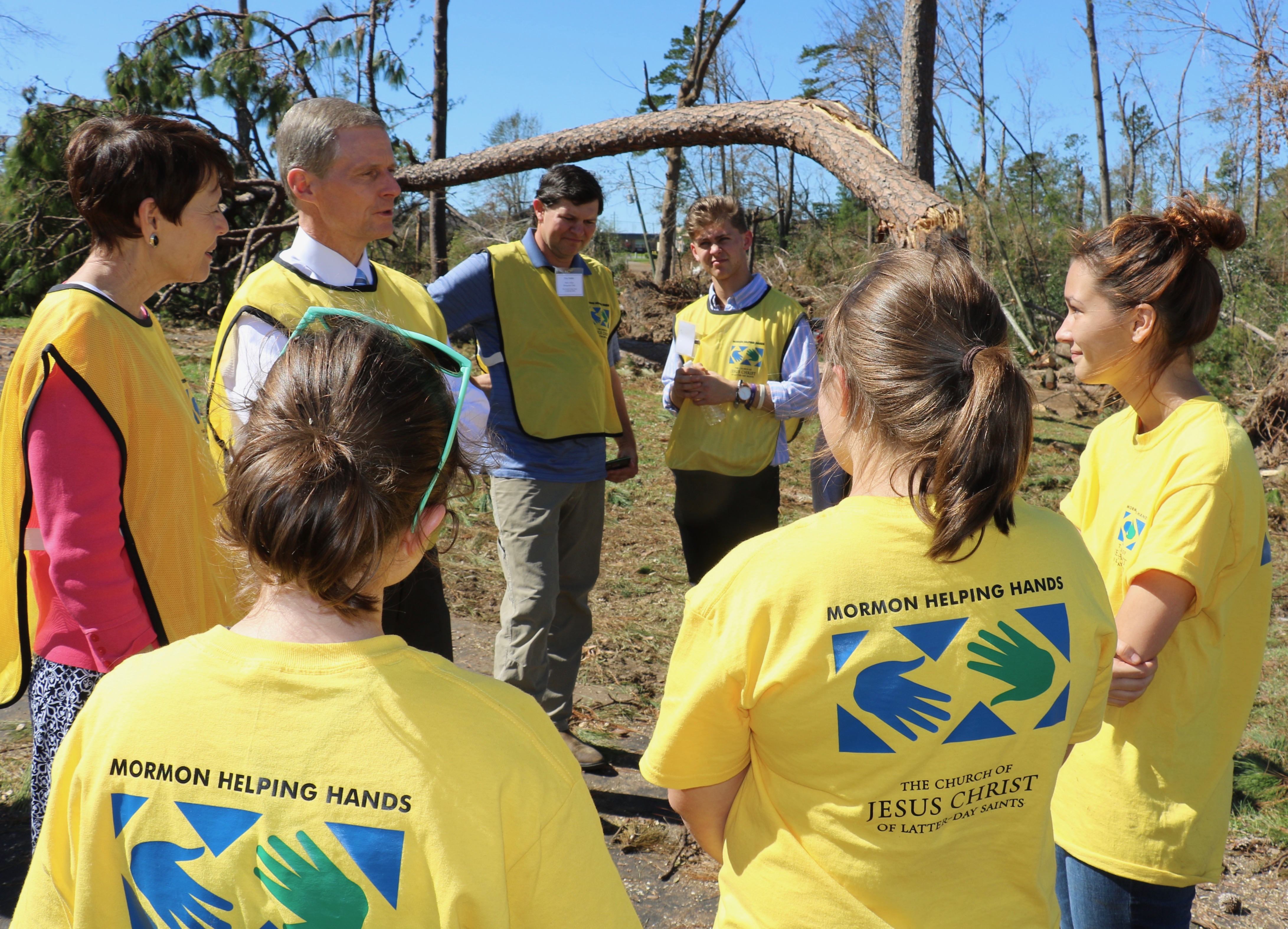 Helping Hands volunteers in Marianna, Florida, take a break for a few minutes on Oct. 21, 2018, to speak with Elder David A. Bednar of The Church of Jesus Christ of Latter-day Saints' Quorum of the Twelve Apostles and Sister Susan Bednar.
