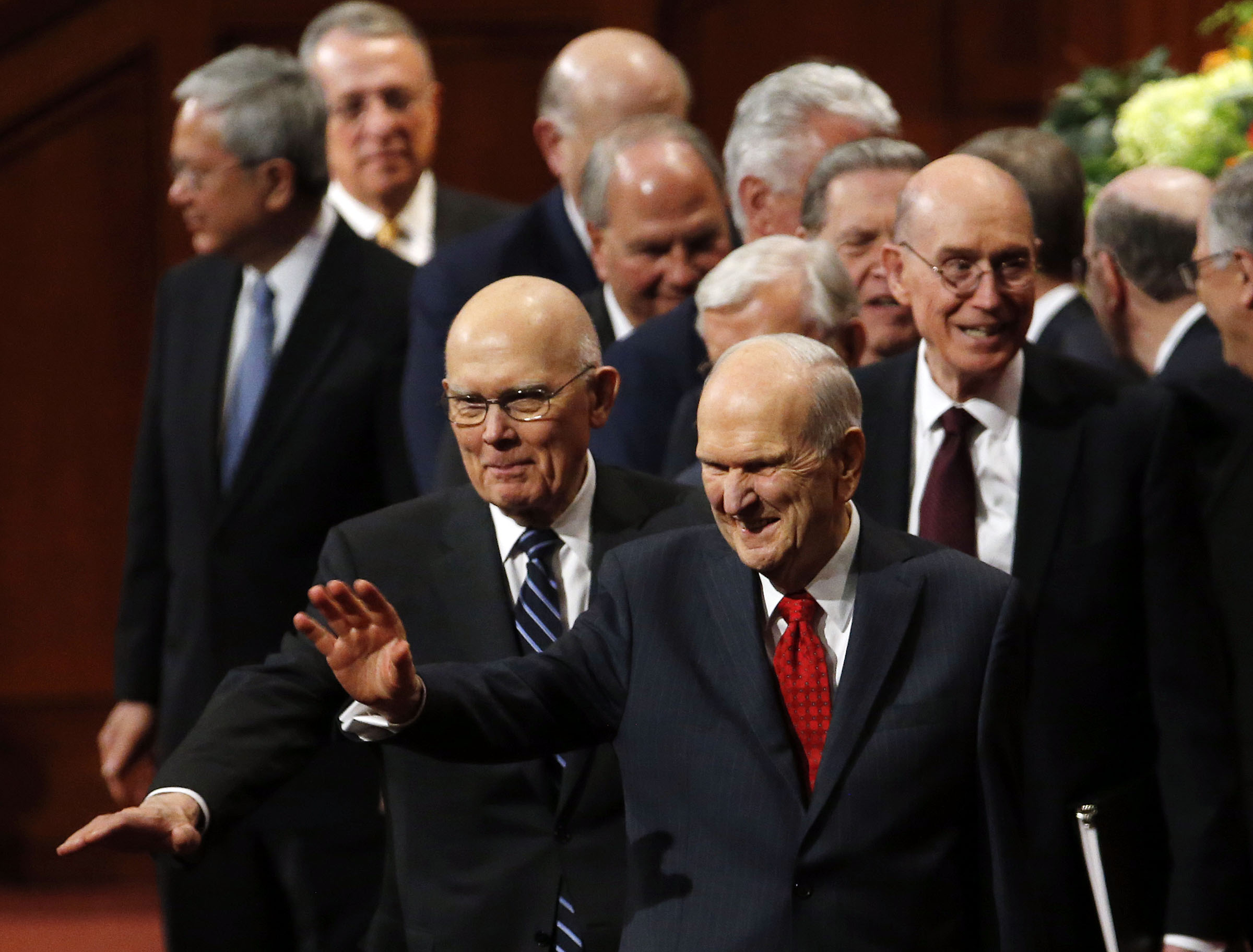 President Russell M. Nelson of The Church of Jesus Christ of Latter-day Saints, front, waves as he and his counselors, President Dallin H. Oaks, first counselor in the First Presidency, left, and President Henry B. Eyring, second counselor in the First Presidency, right, leave the Conference Center following the priesthood session of the 189th Annual General Conference in Salt Lake City on Saturday, April 6, 2019.