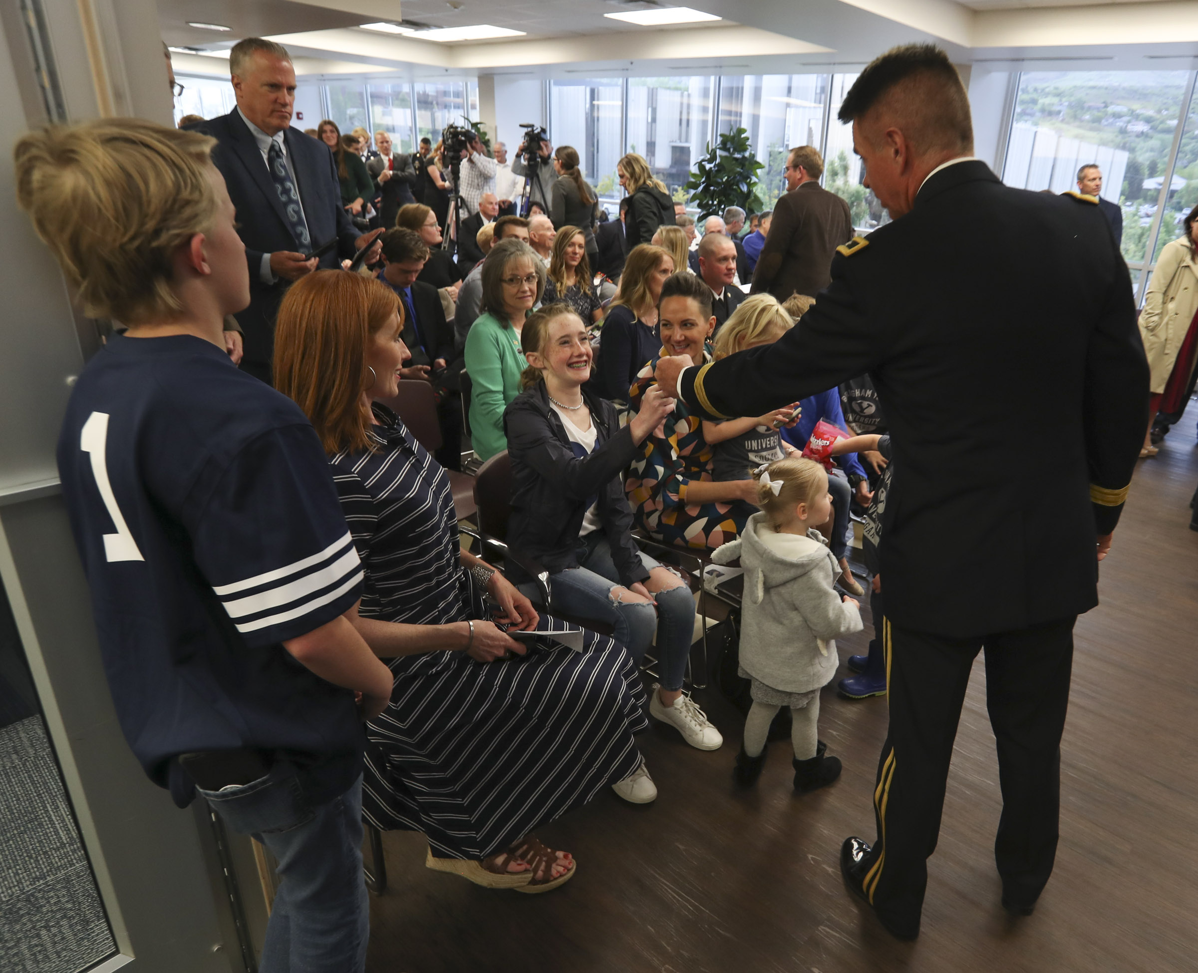 Maj. Gen. Jefferson S. Burton talks with Jennie Taylor and her children during a ceremony where the name of her husband, Maj. Brent Taylor, was added to the Reflection Room Memorial Wall in the Wilkinson Center on the BYU campus in Provo on Thursday, May 23, 2019. Taylor was killed in Afghanistan in 2018.