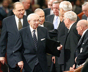 LDS president Gordon B. Hinckley (front) first counselor Thomas S. Monson (left) and 2nd conselor James E. Faust (behind Hinckley) shake hands with members of the quorum of the 12 following the Sunday afternoon session of the 176th annual general conference of the Church of Jesus Christ of Latter-day Saints in Salt Lake City, Utah April 2, 2006. Photo by Keith Johnson/Deseret Morning News 176th annual.
