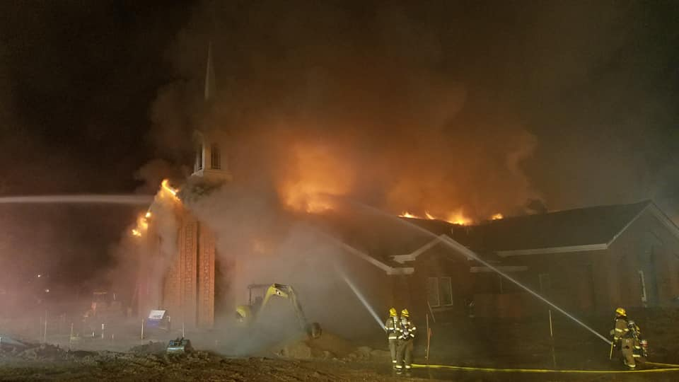 Firefighters battle a blaze consuming the under-construction St. George East Stake center early Saturday morning, July 26, 2019, in St. George, Utah.