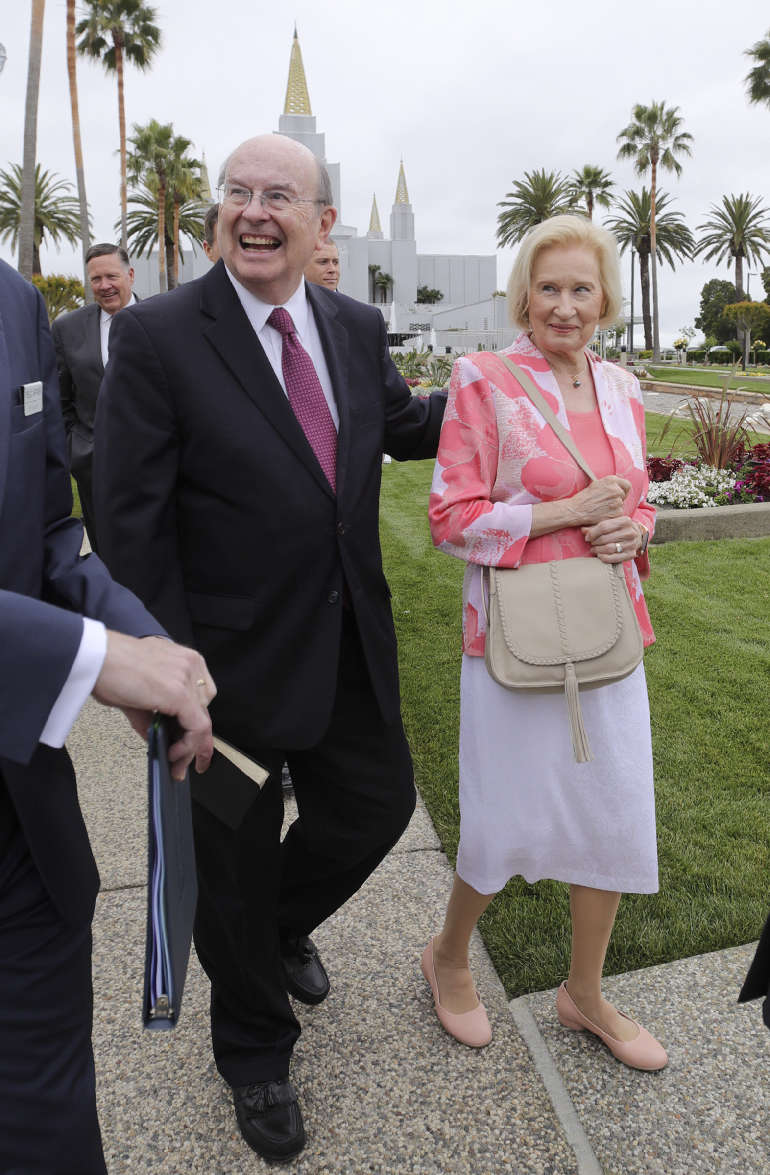 Elder Quentin L. Cook, of the Quorum of the Twelve Apostles, and his wife, Sister Mary G. Cook, walk the temple grounds after finishing a tour of the newly renovated Oakland California Temple, of The Church of Jesus Christ of Latter-day Saints, in Oakland, Calif., on Monday, May 6, 2019.