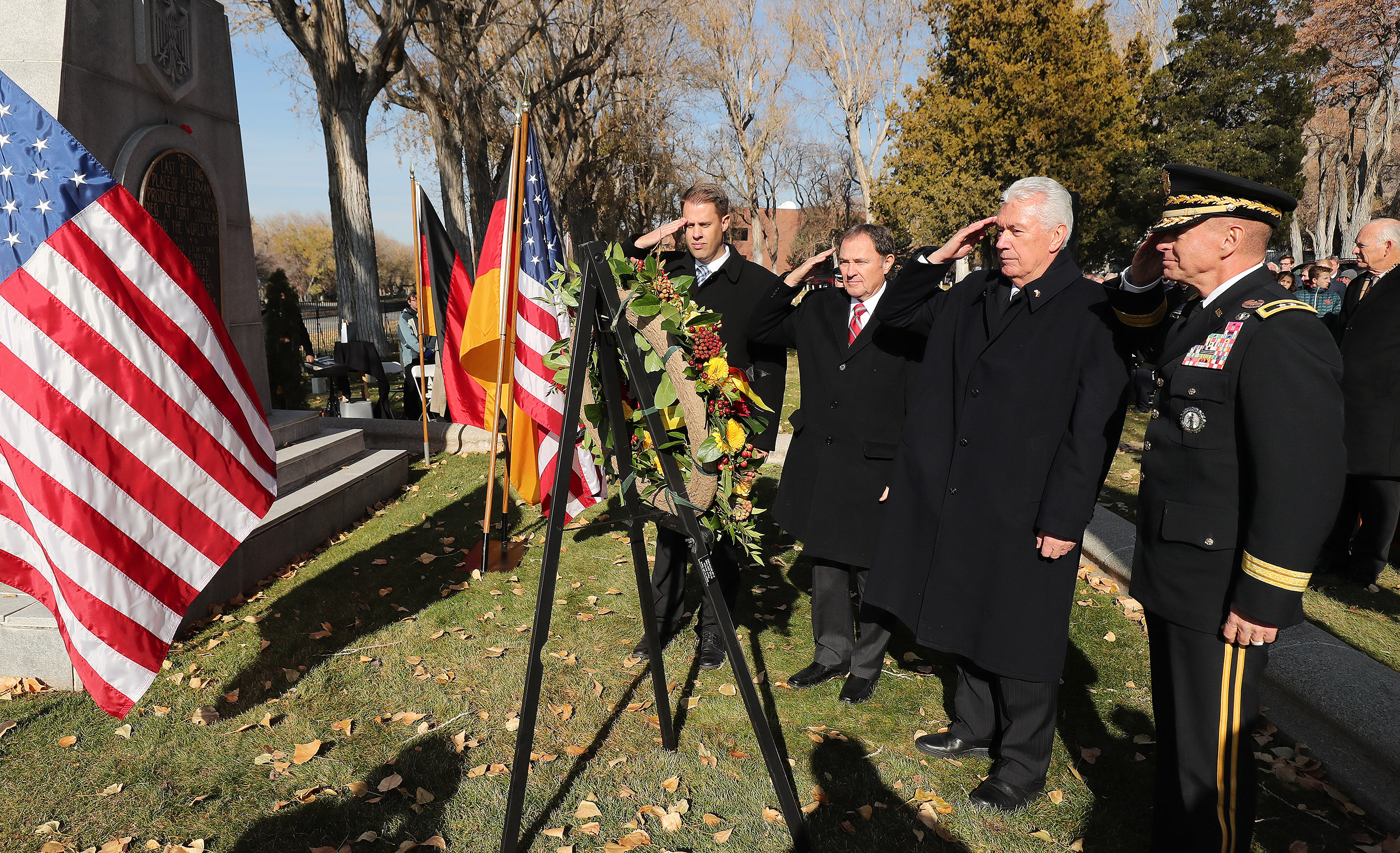 Gov. Gary Herbert , Elder Dieter F. Uchtdorf of The Church of Jesus Christ of Latter-day Saints' Quorum of the Twelve Apostles, General Adjutant General of the Utah National Guard Jefferson Burton and James Burton salute after placing a wreath during the German Day of Remembrance (Volkstrauertag) at Fort Douglas Military Cemetery in Salt Lake City on Sunday, Nov. 18, 2018.