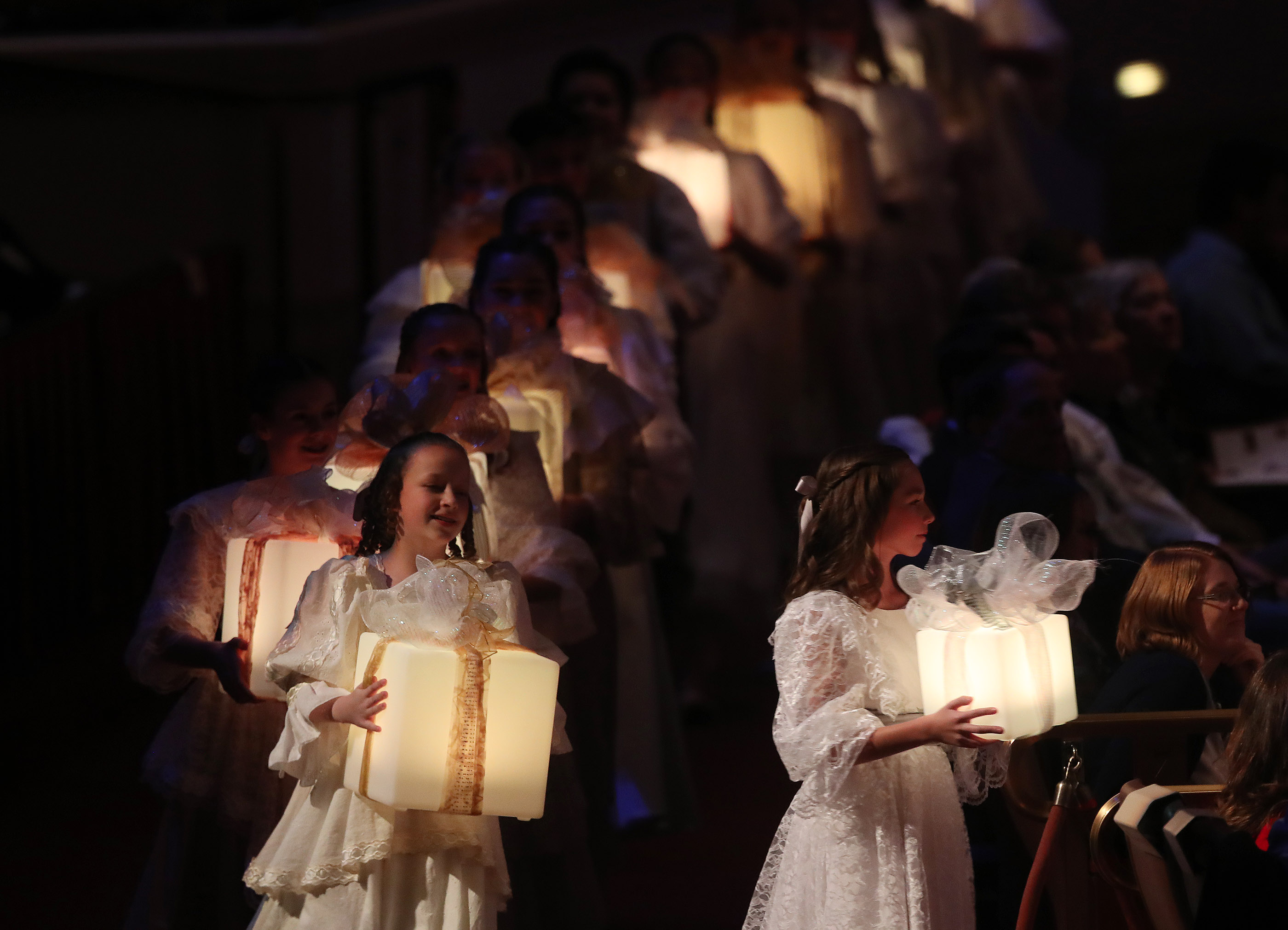 Performers accompany the Tabernacle Choir at Temple Square during their opening Christmas concert at the Conference Center in Salt Lake City on Thursday, Dec. 13, 2018.