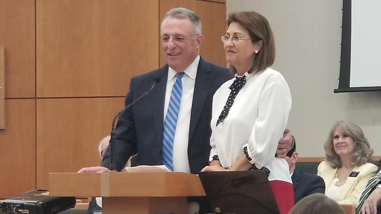 Elder Ulisses Soares of the Quorum of the Twelve Apostles and his wife, Sister Rosana Soares, speak together from the podium in a meeting with missionaries from the Brazil Fortaleza and Brazil Fortaleza East missions Saturday, June 1, 2019.