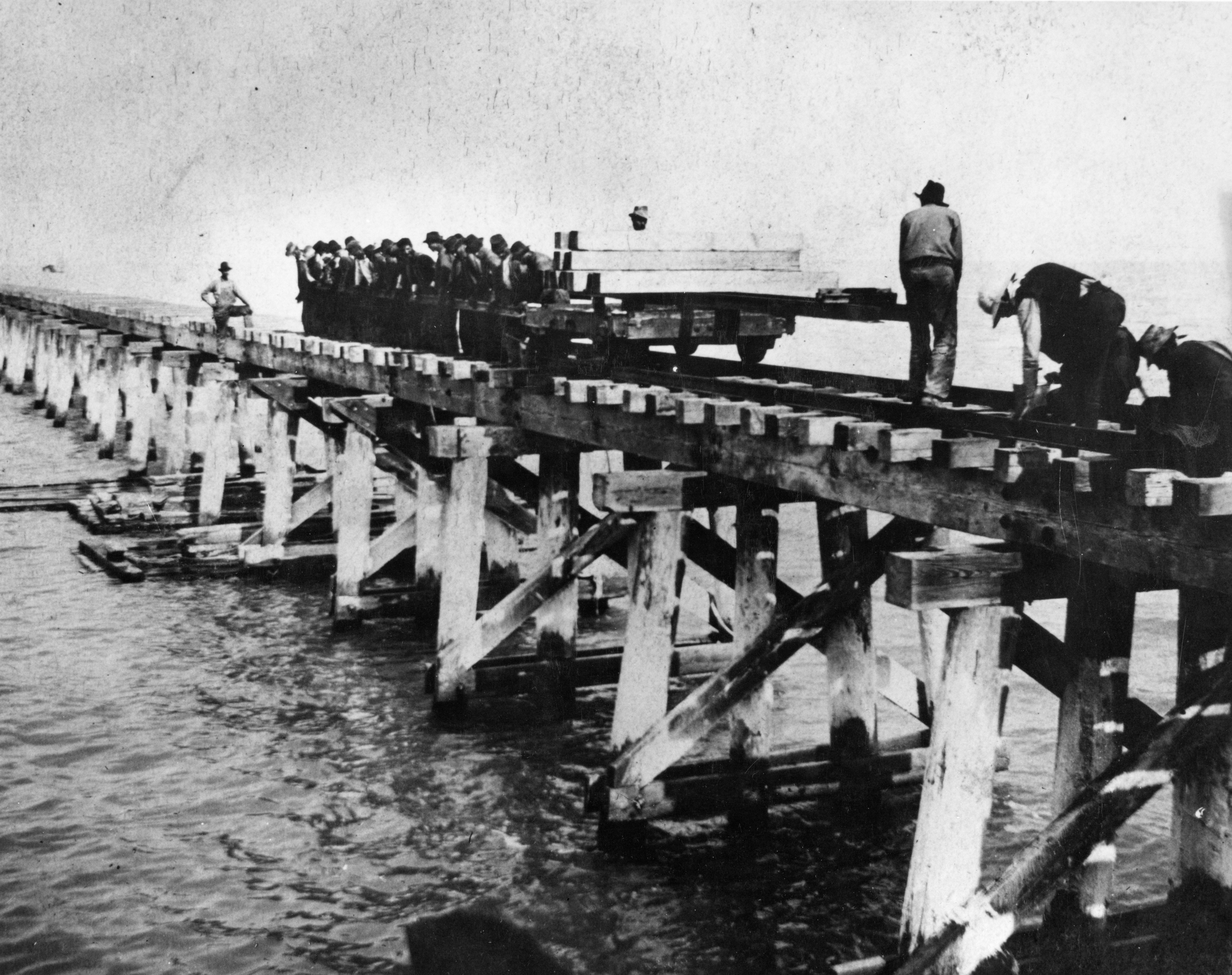 Workers build the Lucin Cutoff bridge in 1902-1903.