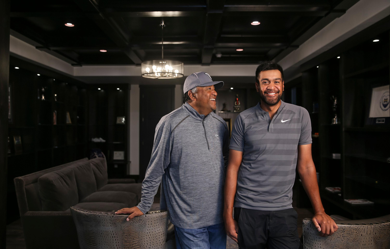 PGA golfer Tony Finau, right, and his father, Kelepi Finau, pose for a photo at Tony's home in Lehi on Tuesday, Feb. 6, 2018.