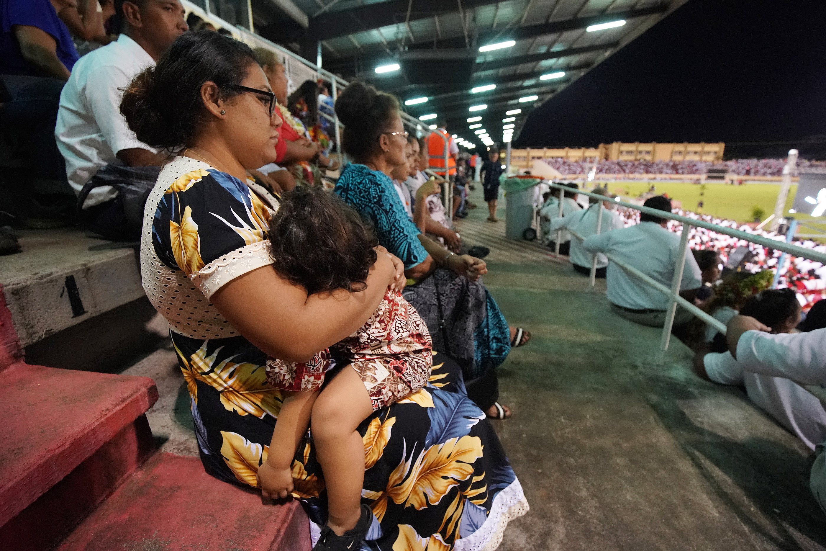 Attendees listen to speakers during a devotional at Stade Pater stadium in Papeete, Tahiti, on May 24, 2019.